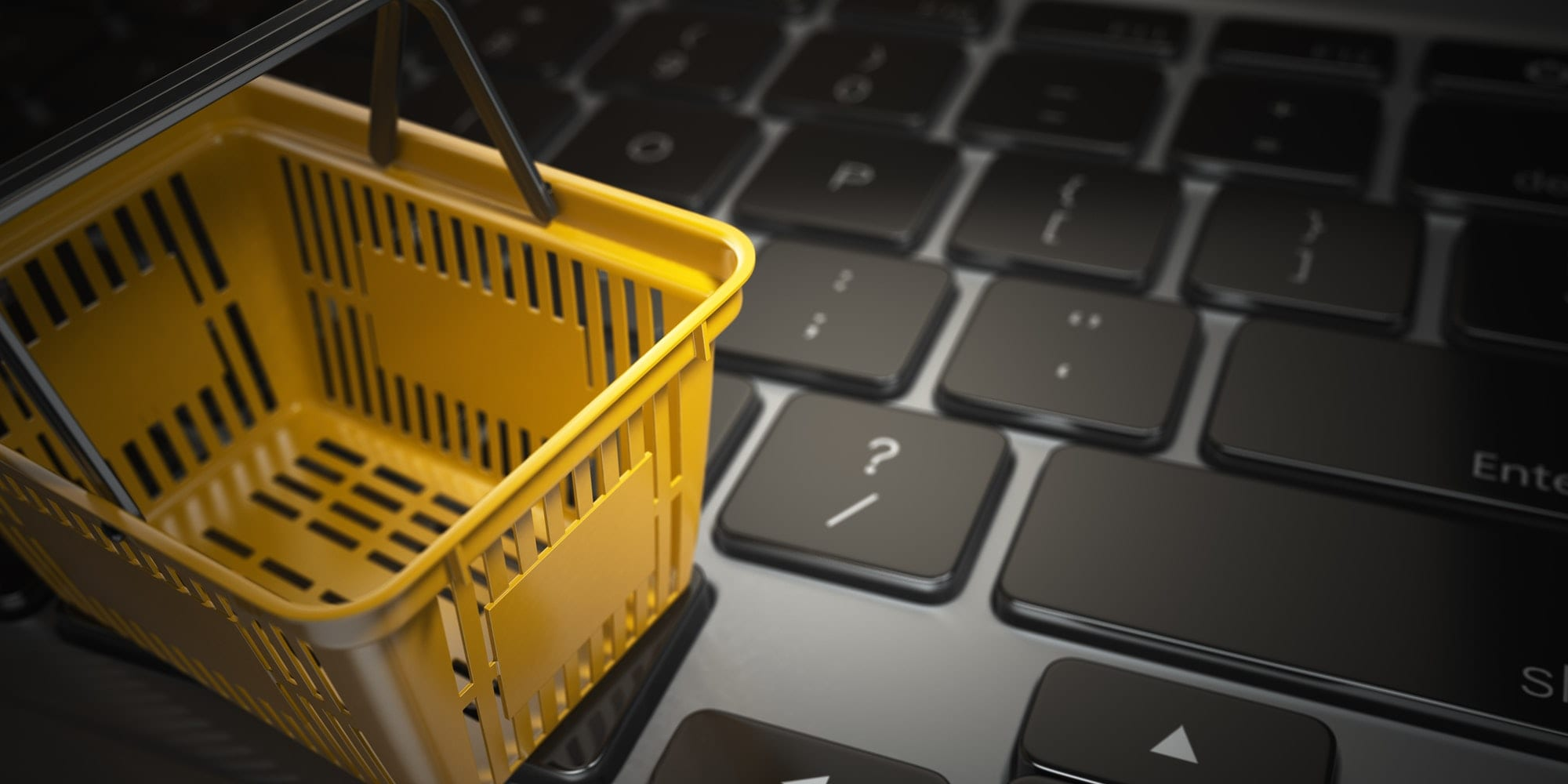 yellow shopping basket on laptop keyboard